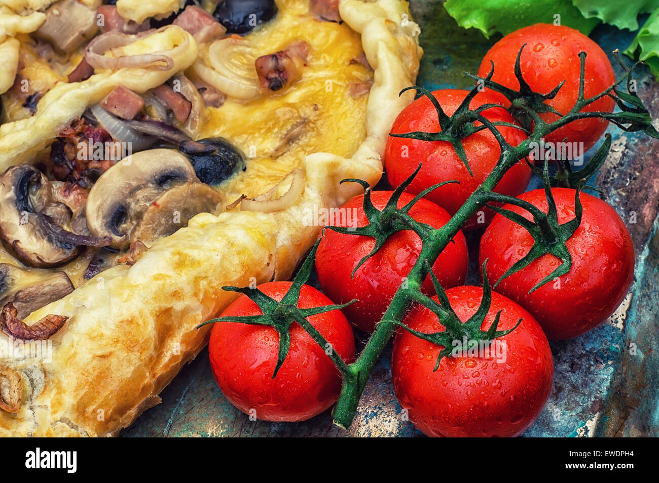 baked in the oven meat shawarma with vegetables in a rustic style.The image is tinted - Stock Image