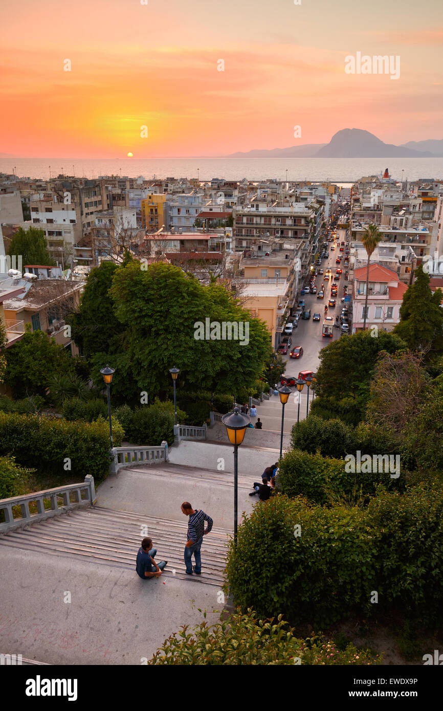 People enjoying the view of the city of Patras from the staircase leading from city centre to the top of the castle - Stock Image