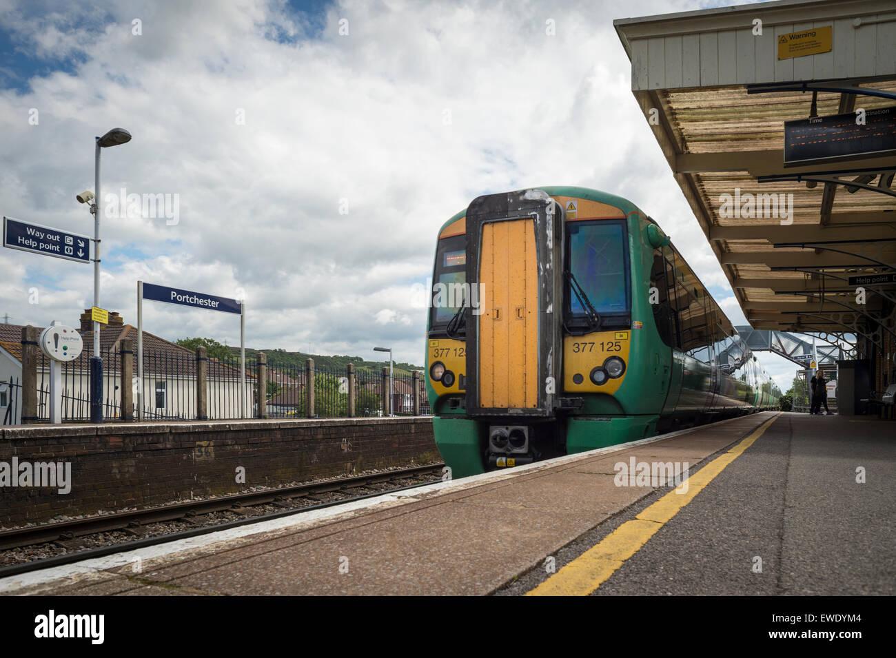 Train arriving at the platform at Portchester station - Stock Image