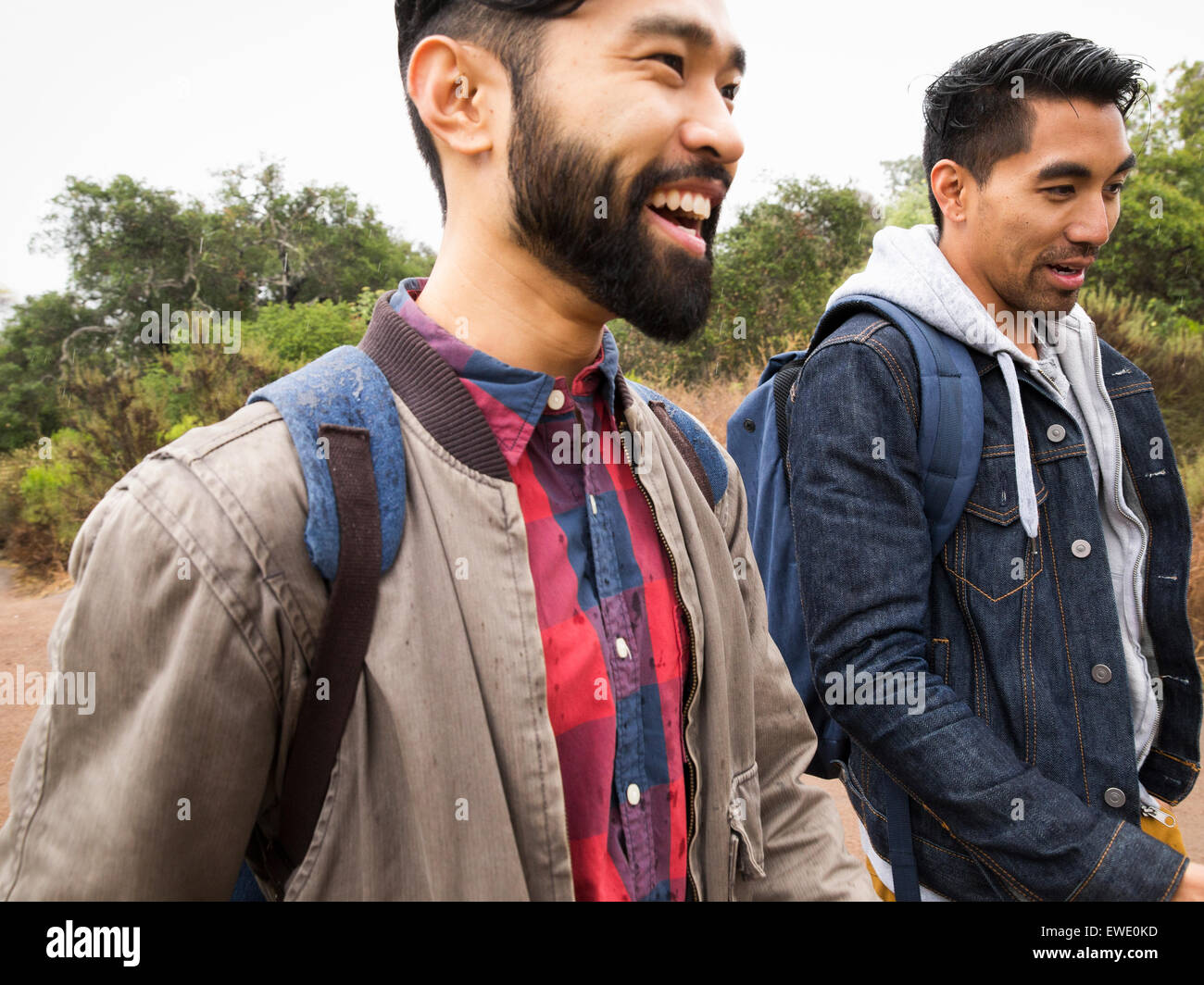 Two young men walking in a park - Stock Image