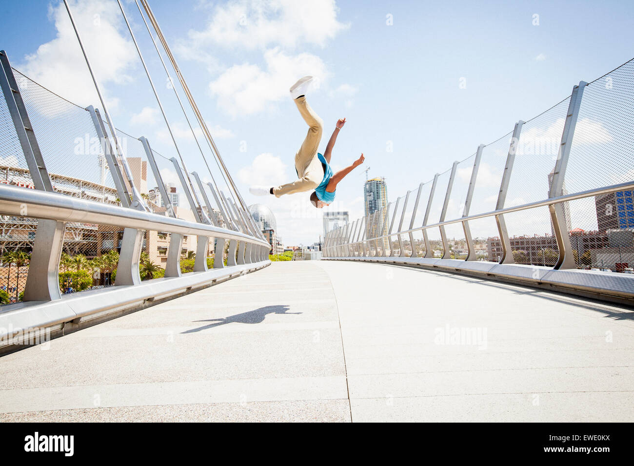 Young man somersaulting on street parcour parkour - Stock Image