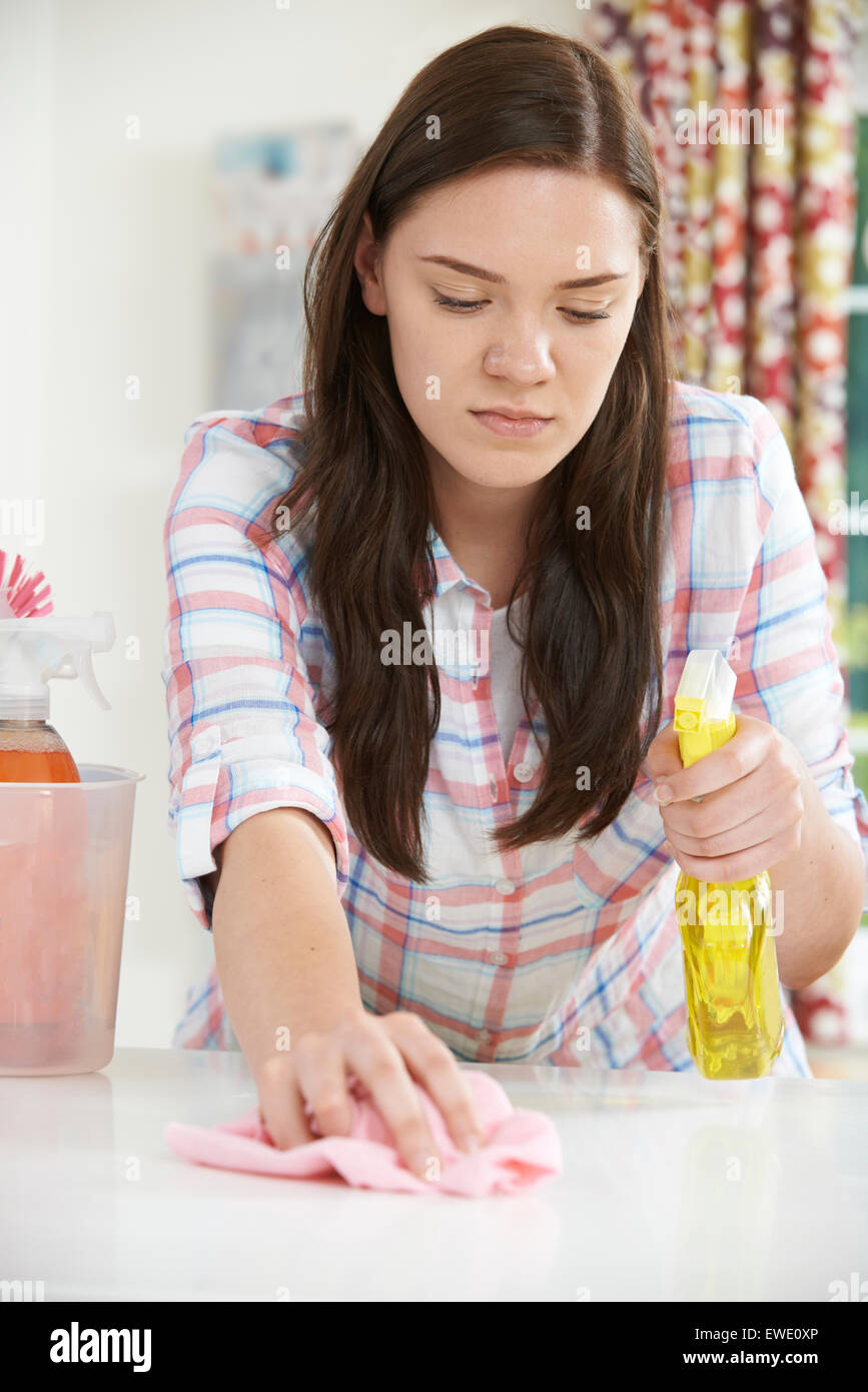 Teenage Girl Helping With Cleaning At Home - Stock Image