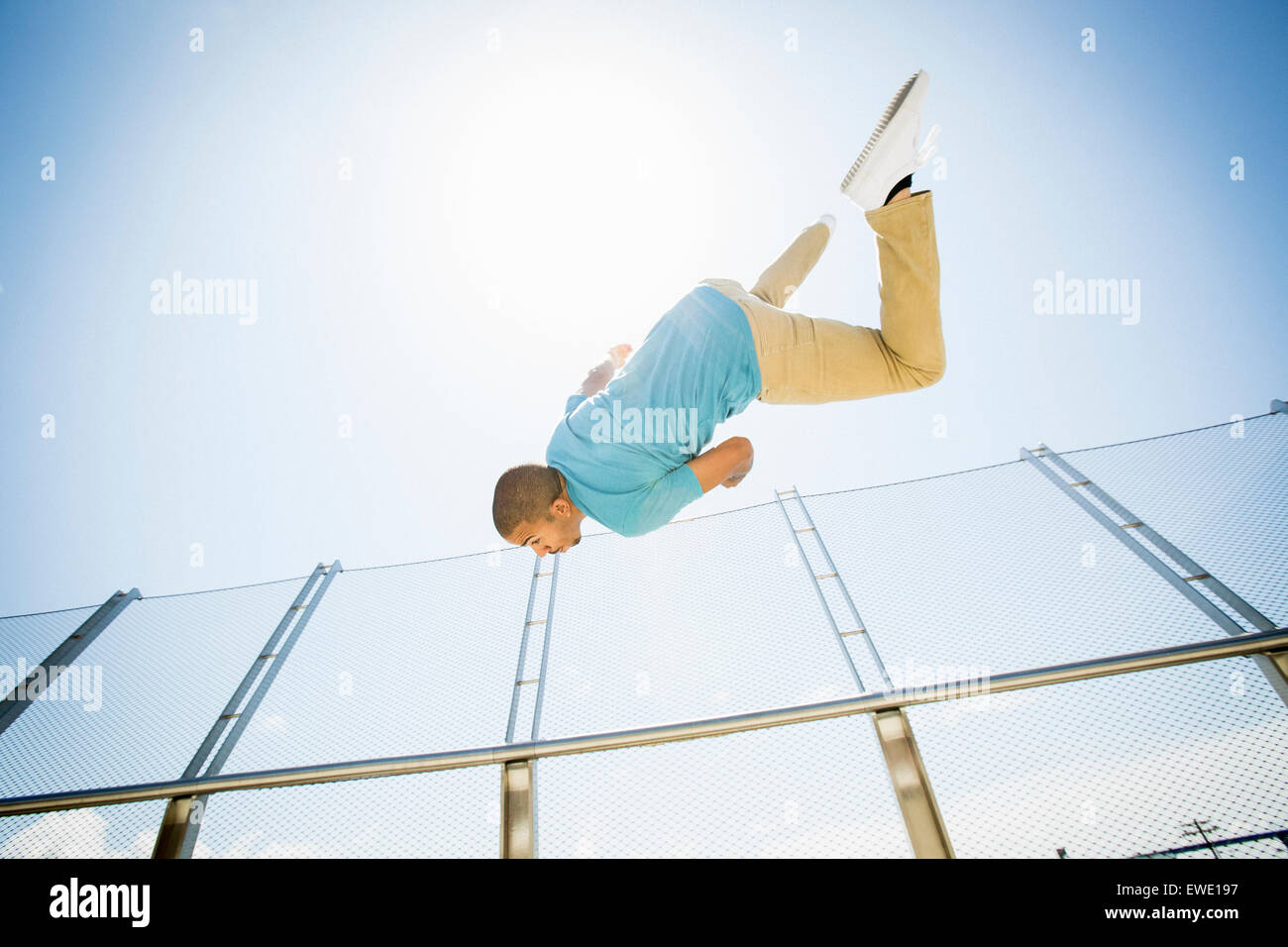 Young man somersaulting parcour parkour free running Stock Photo
