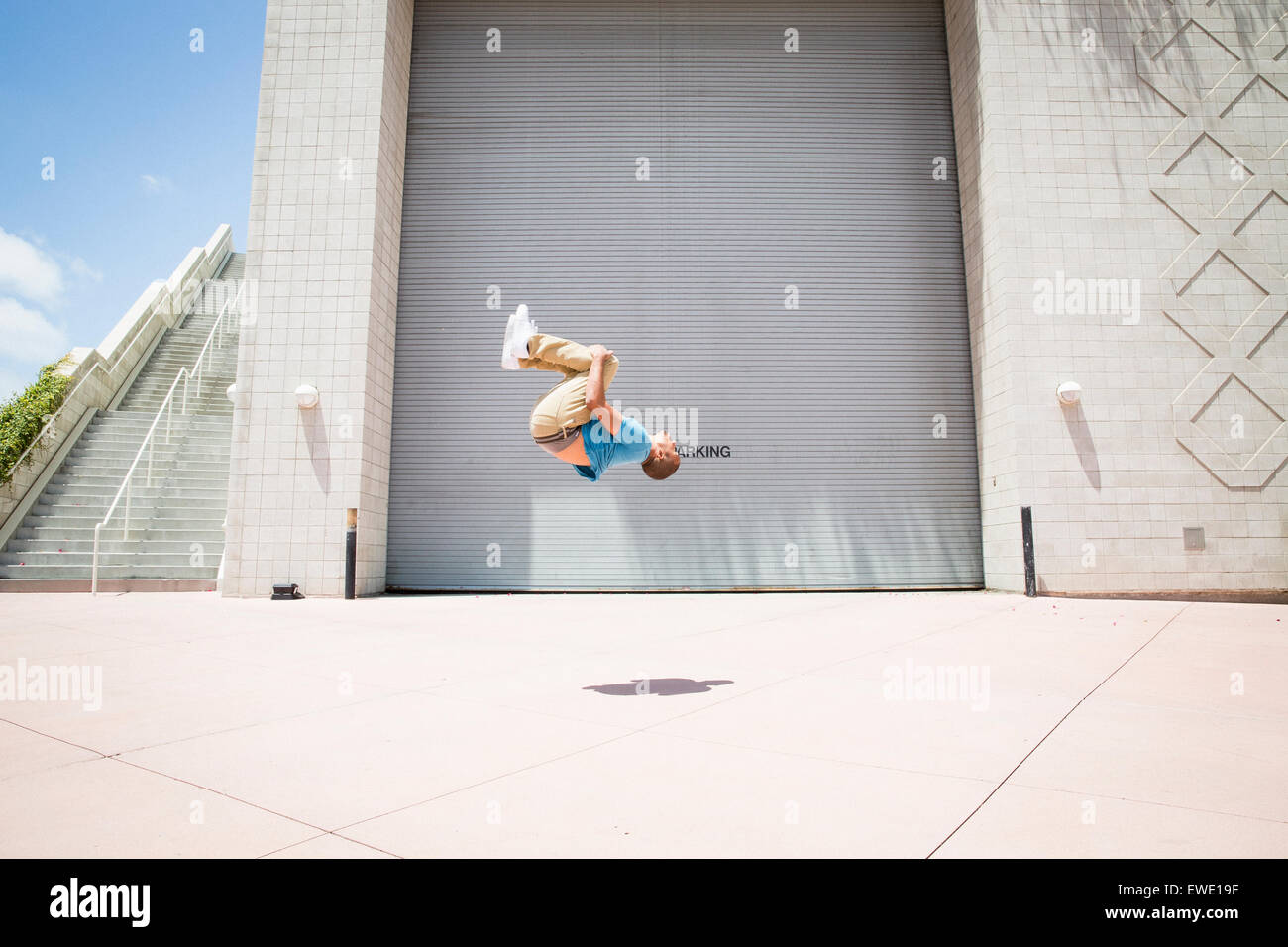 Young man somersaulting on street parcour parkour free running Stock Photo