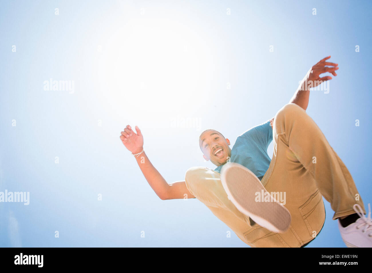 Parcour parkour young man jumping in the air - Stock Image