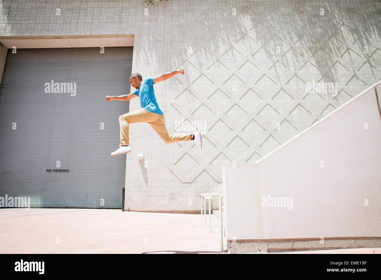 Young man jumping down a stair parcour parkour - Stock Image
