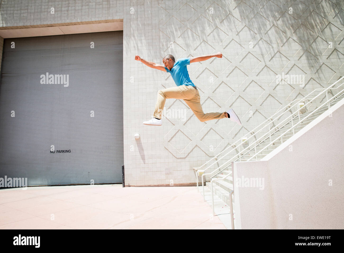Young man jumping down stairs parcour parkour - Stock Image
