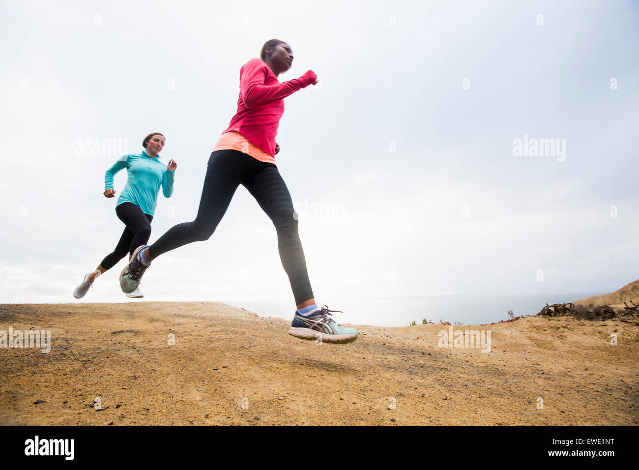 Two women jogging along the coast fitness - Stock Image