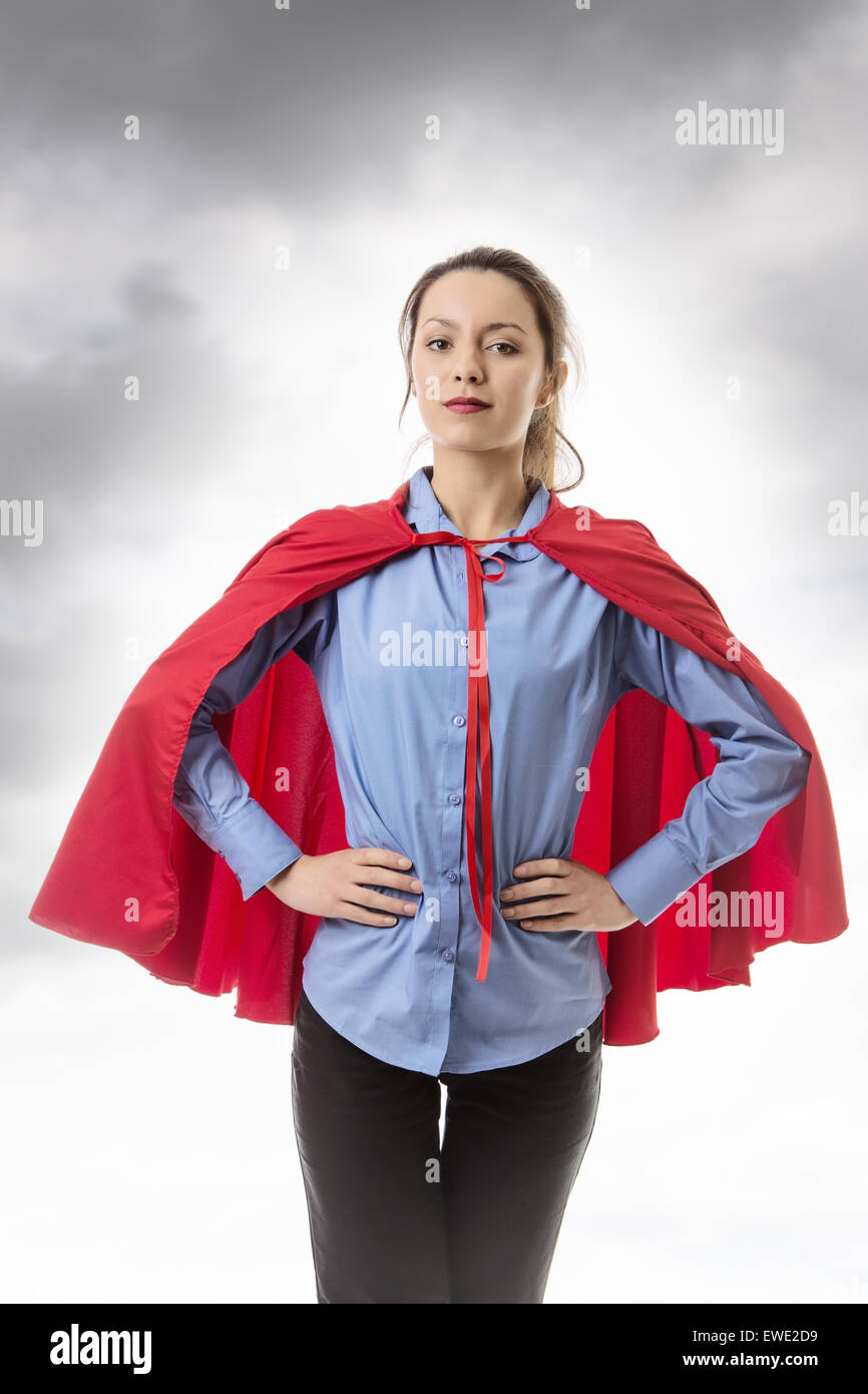 business woman wearing a super hero cape - Stock Image