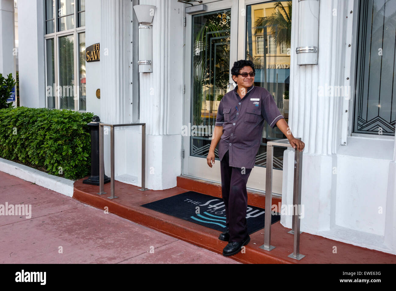 Miami Beach Florida Ocean Drive The Savoy hotel front entrance Hispanic man doorman porter - Stock & Hotel Savoy Doorman Stock Photos u0026 Hotel Savoy Doorman Stock Images ...