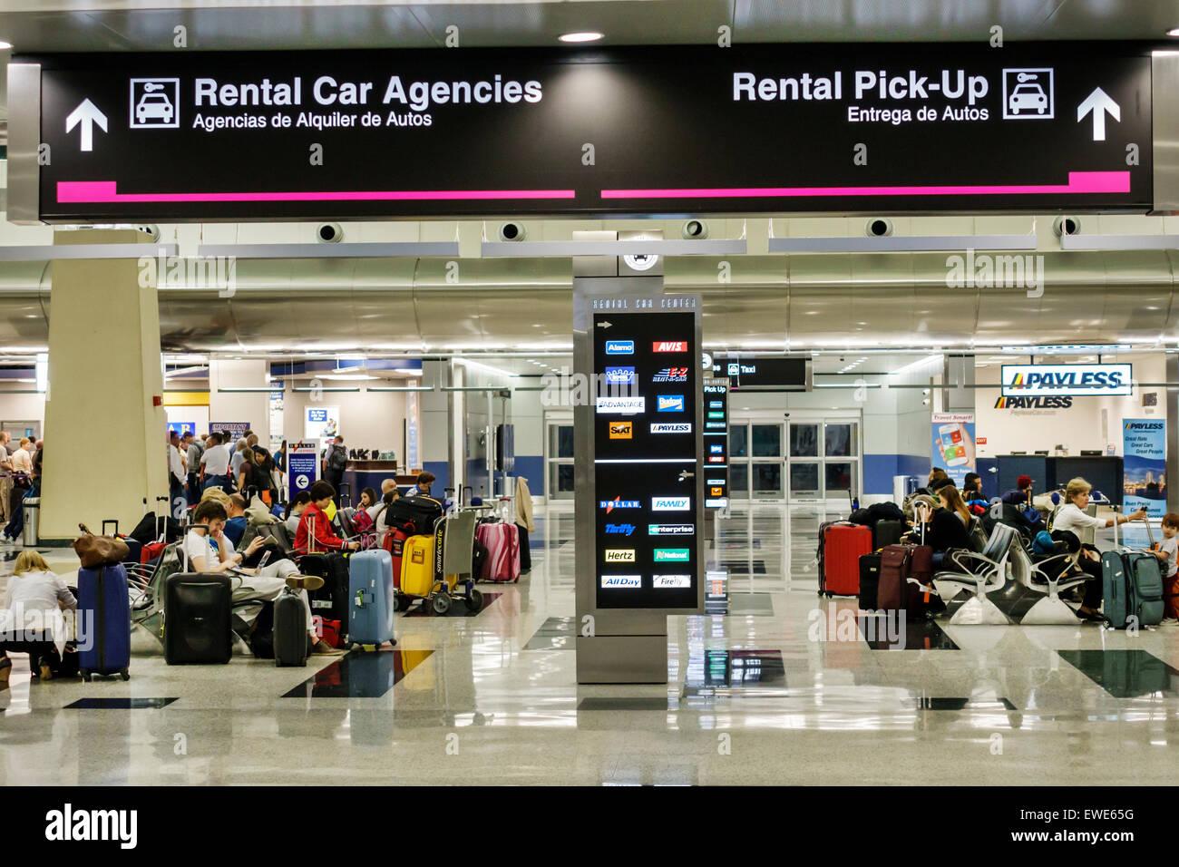 Miami Florida International Airport MIA terminal concourse gate area rental car pick-up sign Spanish English RCC Stock Photo