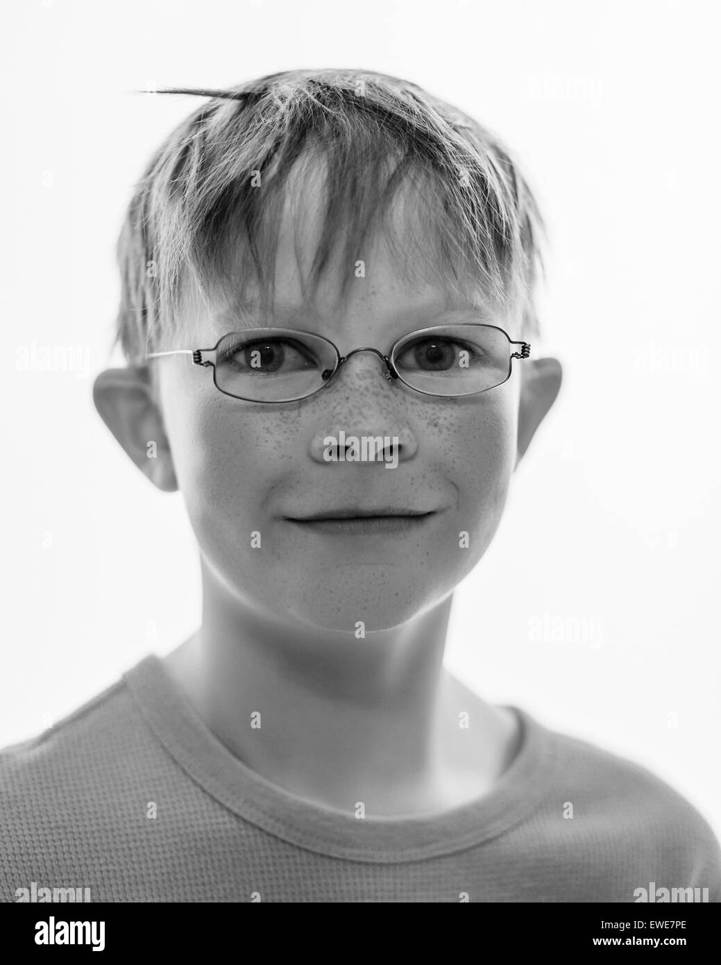 Black and white portrait of 9 year old Icelandic boy with glasses. - Stock Image