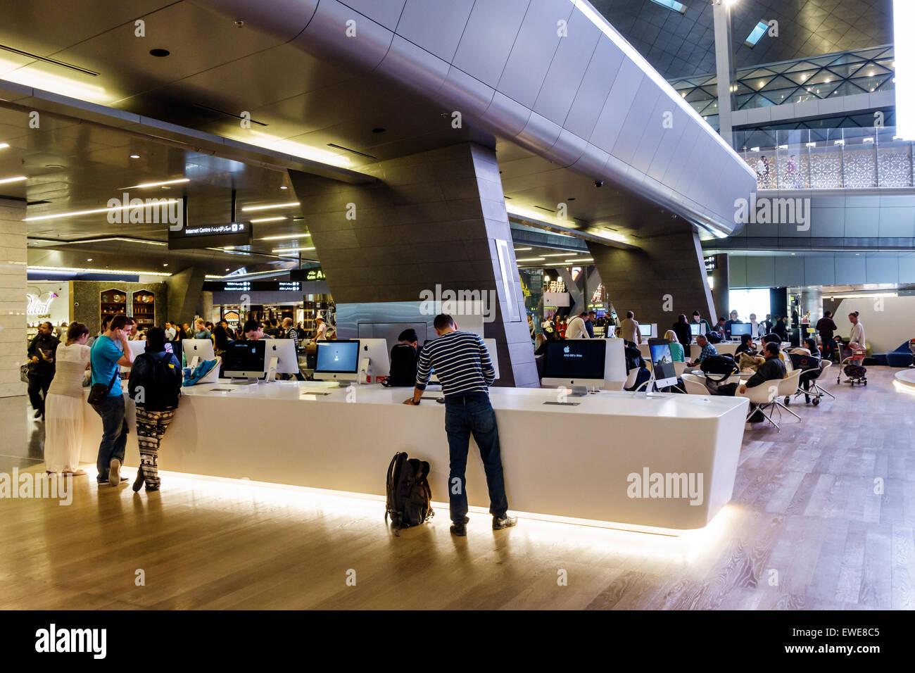 Qatar Doha Hamad International Airport DOH terminal concourse gate area inside interior information help desk Internet Stock Photo