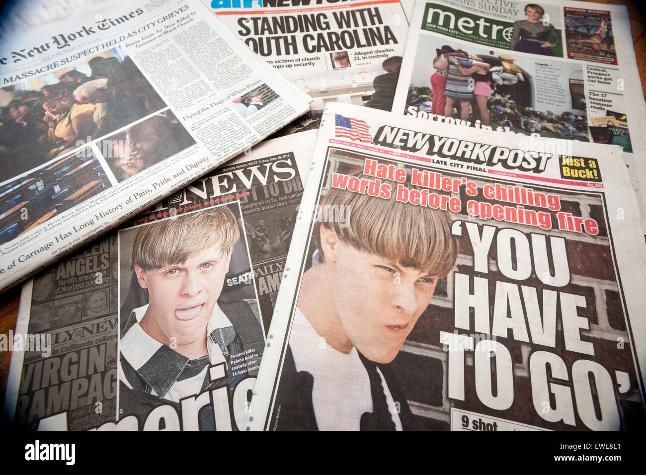 New York newspapers on Friday, June 19, 2015 report on the Tuesday's shooting allegedly by Dylann Storm Roof - Stock Image