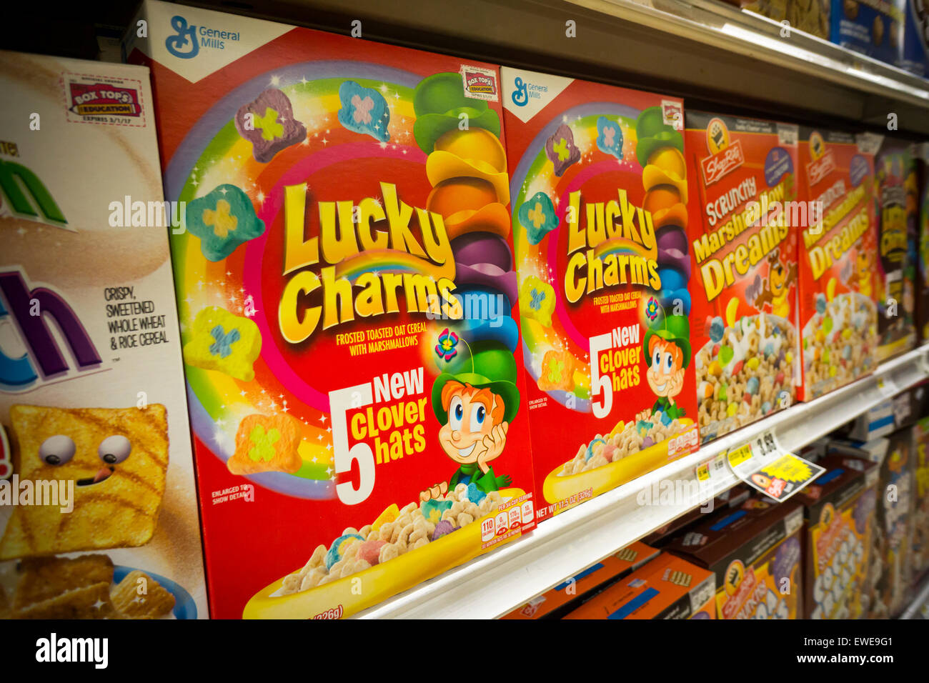 Boxes of General Mills breakfast cereals including Lucky Charms displayed on supermarket shelves in New York on - Stock Image