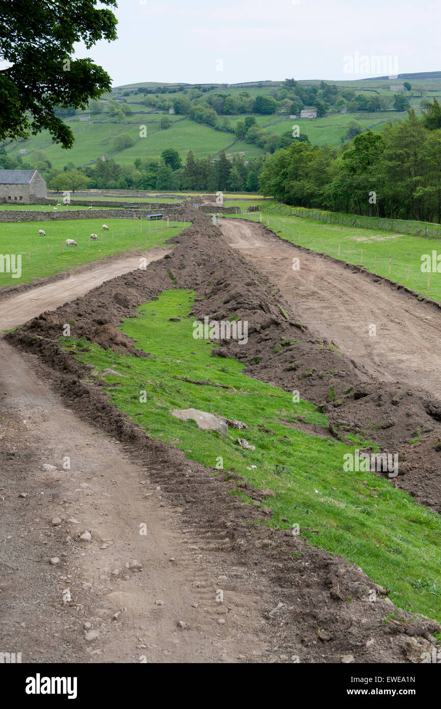 Replacing main water pipeline up Swaledale in North Yorkshire, UK. - Stock Image