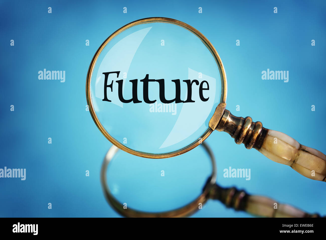 Magnifying glass focus on the word future concept for planning, vision and  looking forward - Stock Image