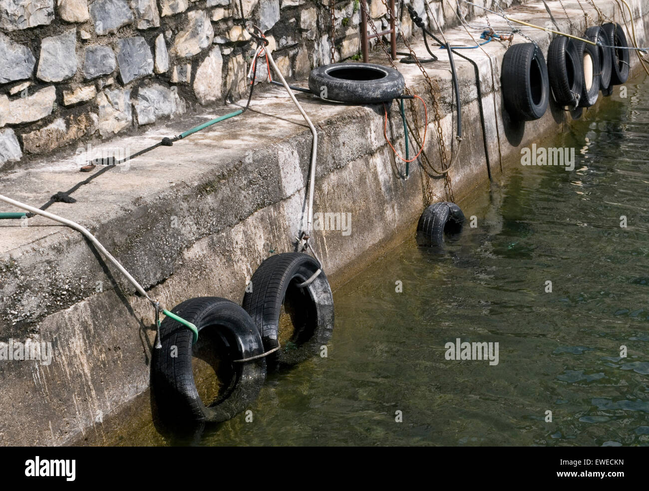 rubber tires used as marine bumpers against the docks - Stock Image