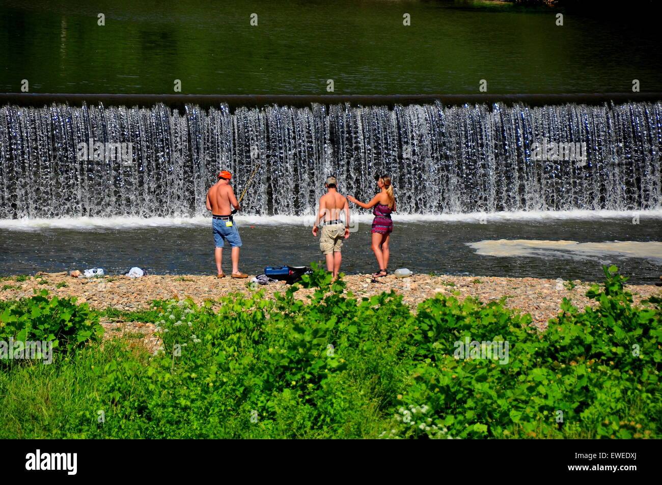 Asheville, Pennsylvania:  Two men and a woman fishing by the falls of the Octoraro Creek * - Stock Image