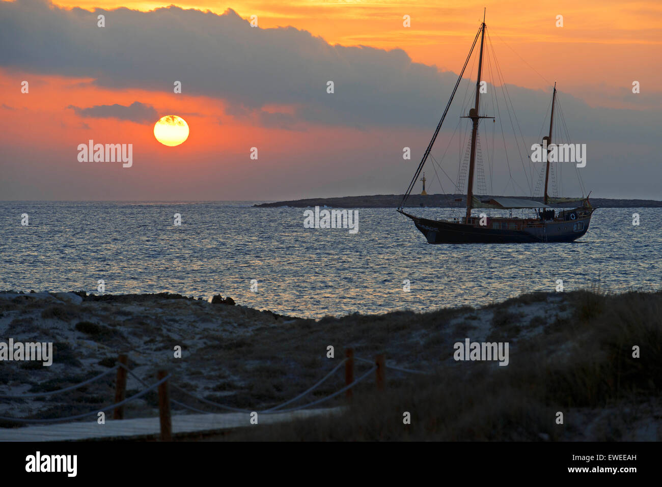Ses Illetes Beach, Balearic Islands, Formentera, Spain. Backlights in the sunset. - Stock Image
