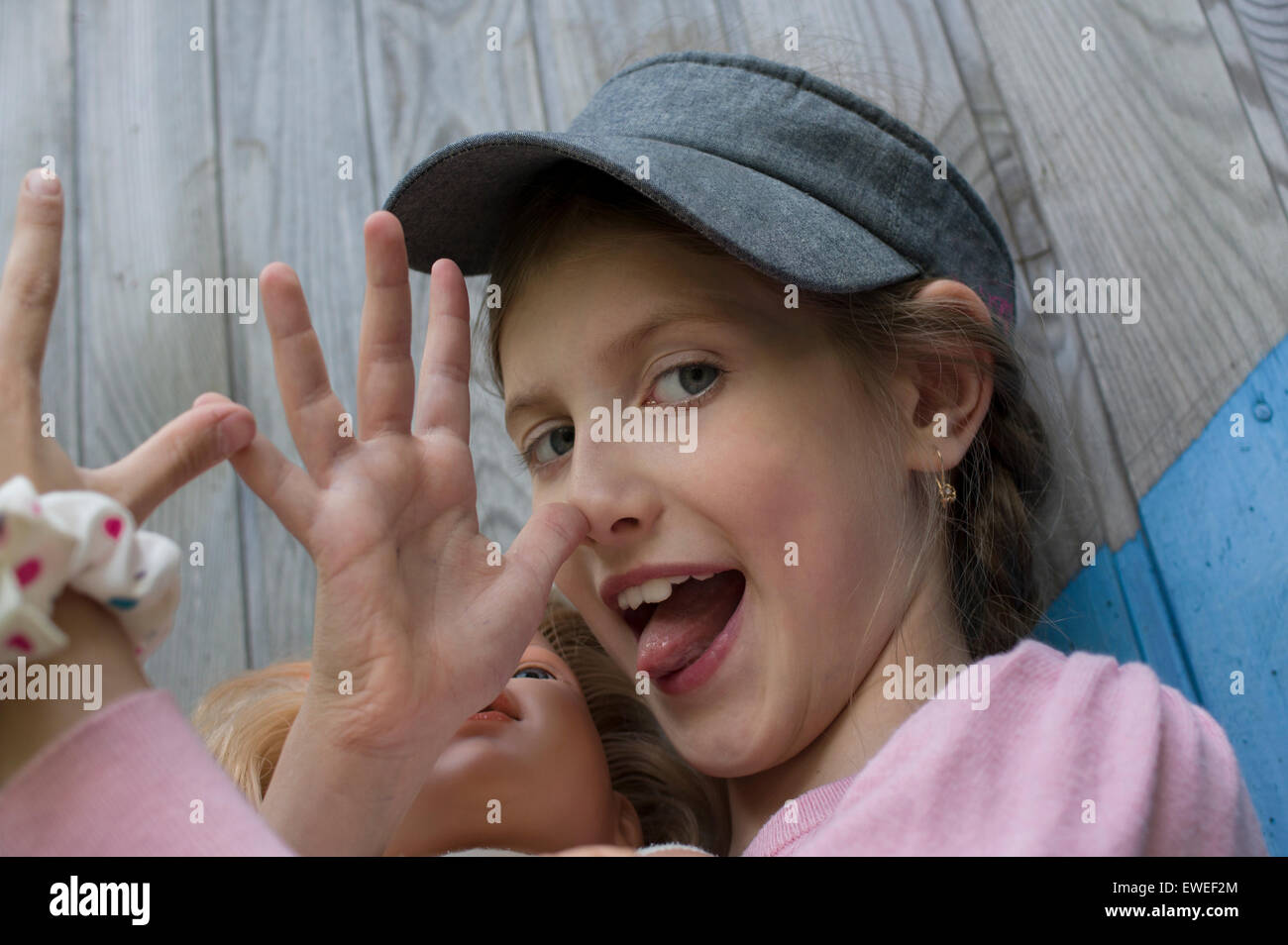 Girl Sticking Out Her Tonque Stock Photo