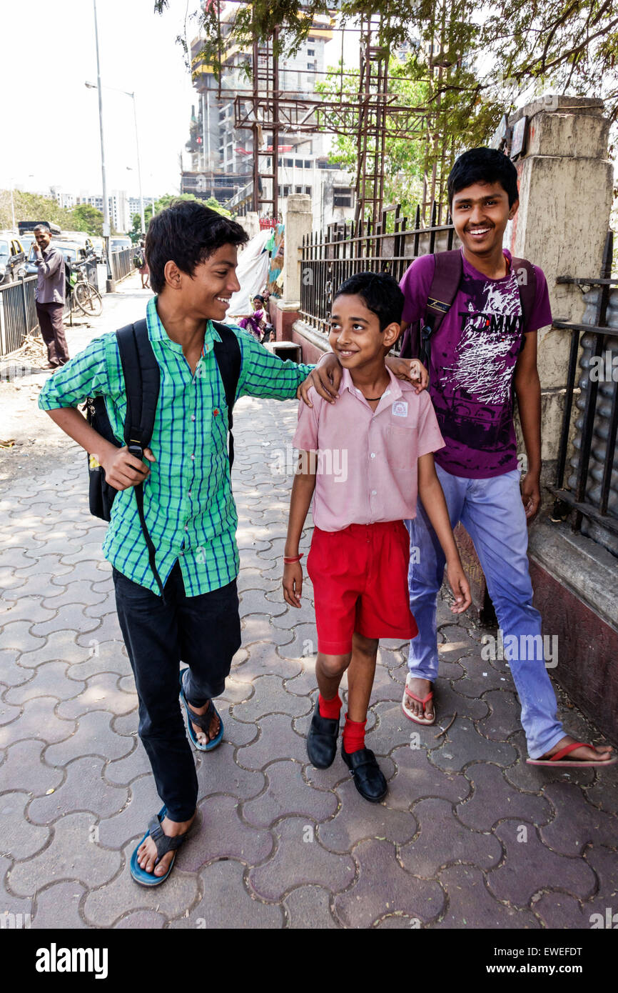 Mumbai India Indian Asian Tardeo Jehangir Boman Behram Road teen boy  friends student younger brother walking home from school
