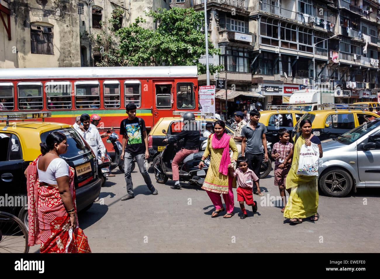 Mumbai India Indian Asian Tardeo Jehangir Boman Behram Road traffic older slum apartments BEST bus motorcycle motor - Stock Image