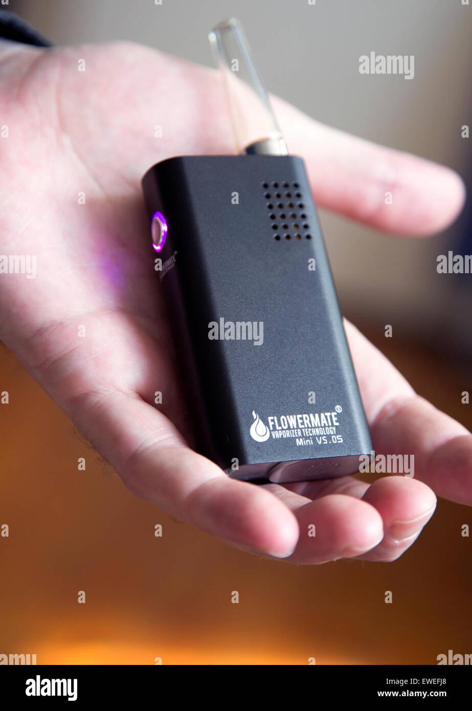 Flowermate Mini portable rechargable vaporiser for consumption of herbs, London - Stock Image