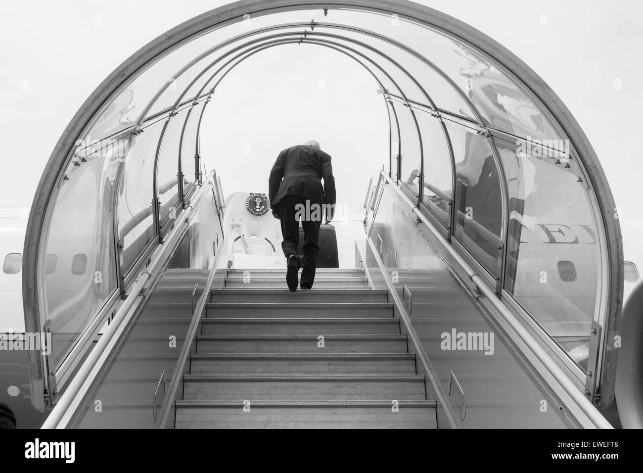 U.S. Secretary of State John Kerry - seen in black-and-white - climbs the stairs to his airplane for a flight to - Stock Image