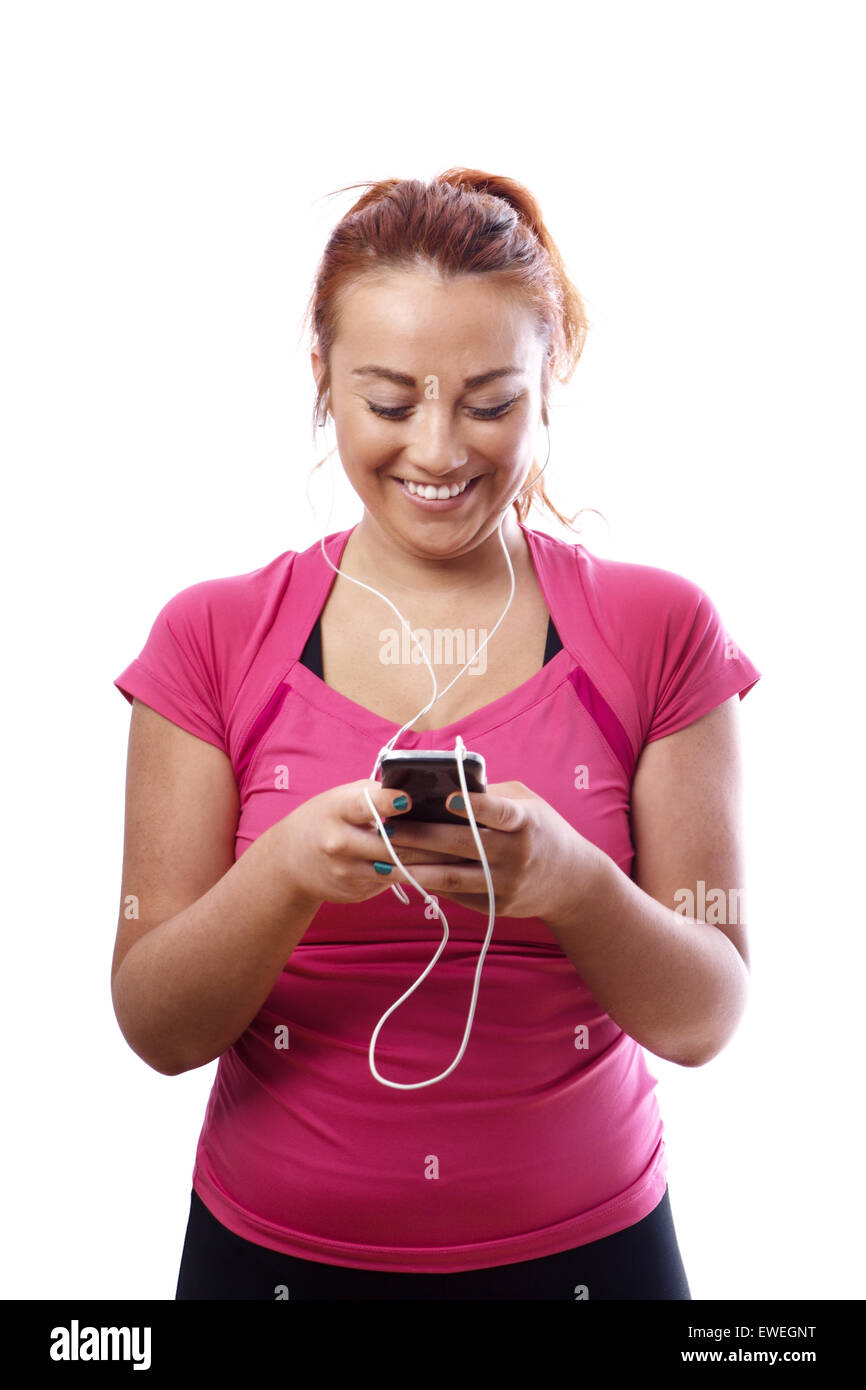 keep fit woman listing to music down the gym on her workout