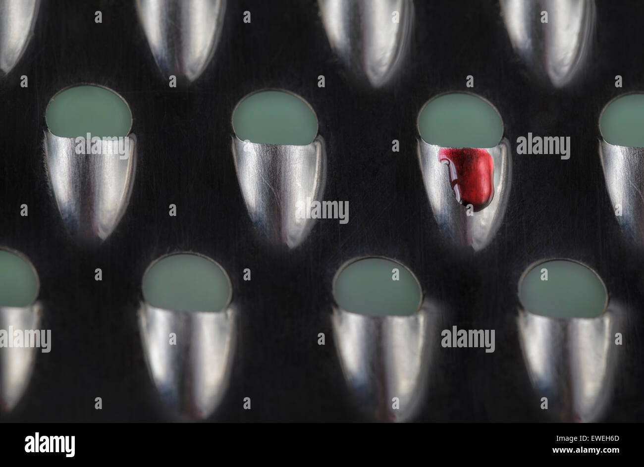Cheese grater with blood drop - Stock Image