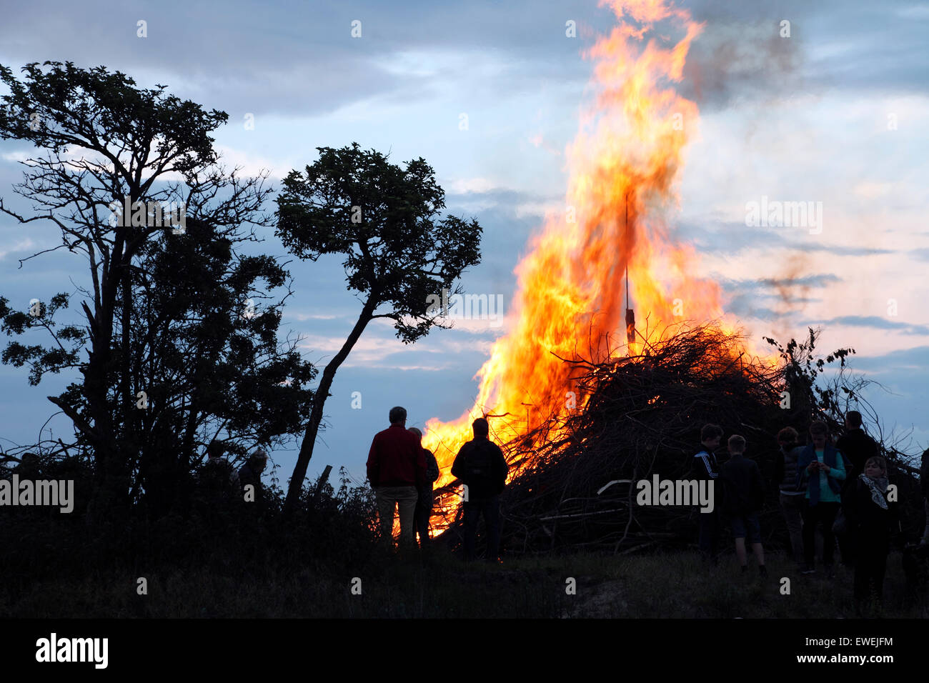 Bonfire on the beach at Nivaa Harbour in celebration of midsummer and St. John's Eve. - Stock Image