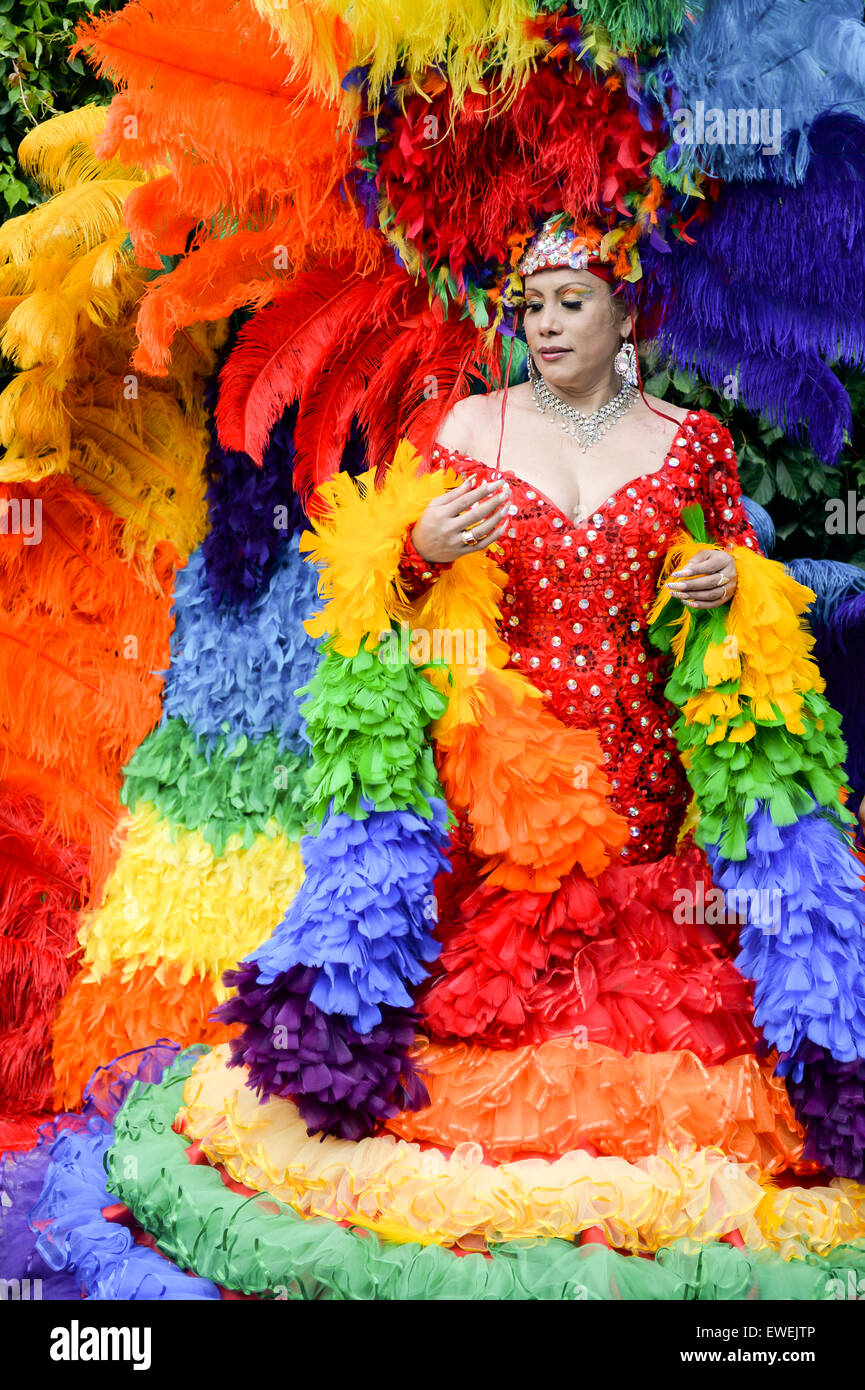 NEW YORK CITY, USA - JUNE 30, 2013: Drag queen celebrates the annual gay pride event in dramatic rainbow dress with - Stock Image