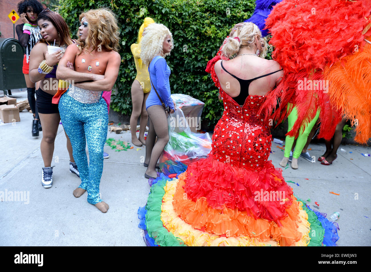 NEW YORK CITY, USA - JUNE 30, 2013: Drag queen in dramatic rainbow dress celebrates the annual gay pride event with - Stock Image