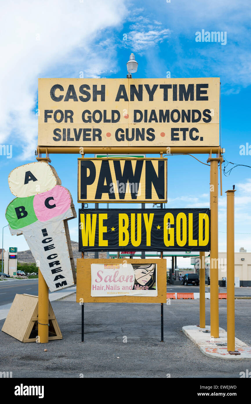 WENDOVER, NEVADA - AUGUST 18, 2013: Sign for American pawn shop advertises cash anytime for gold, diamonds, silver, - Stock Image