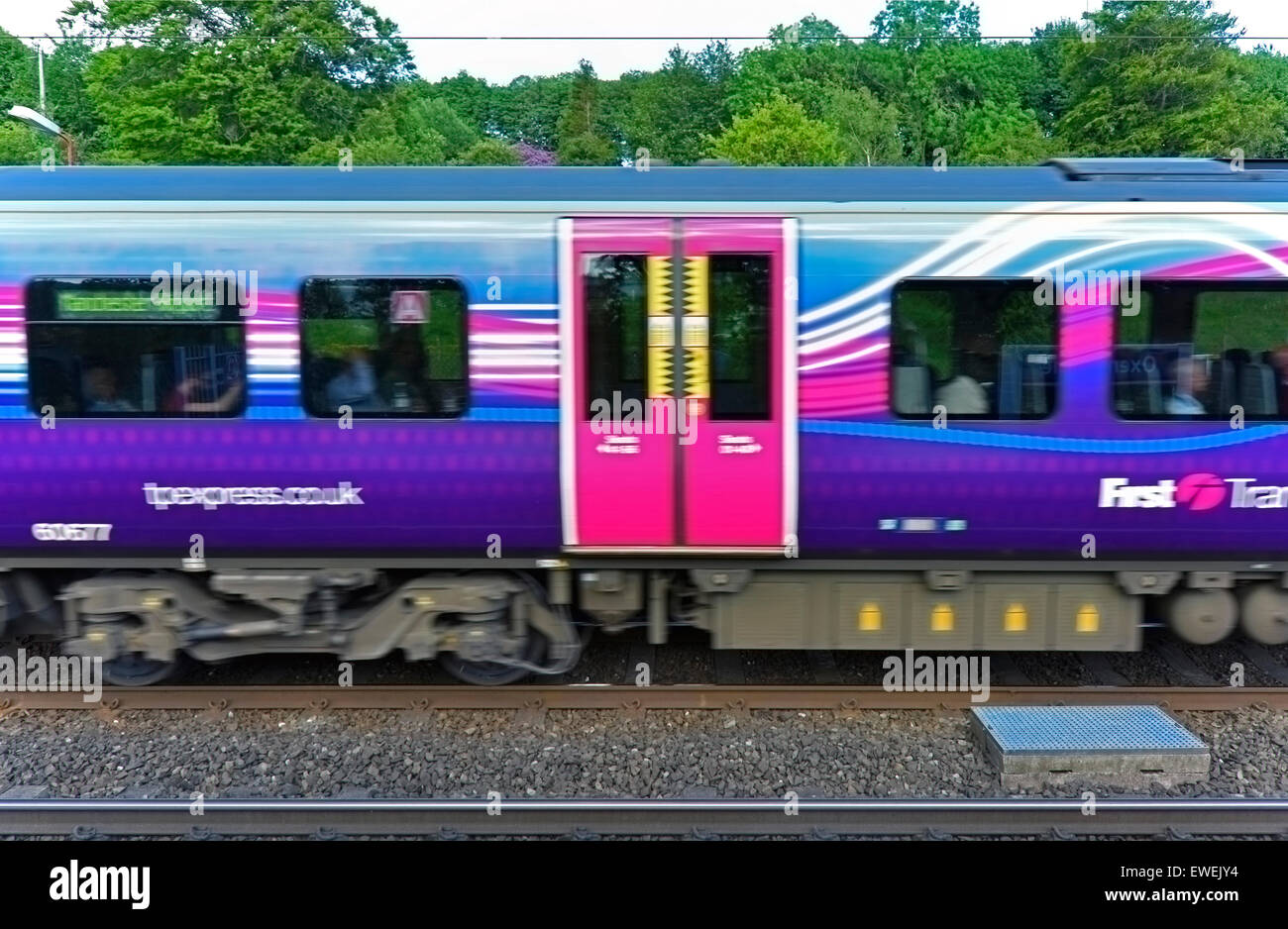 First Transpennine Express train at speed. Oxenholme Rail Station, Cumbria, England, United Kingdom, Europe. - Stock Image