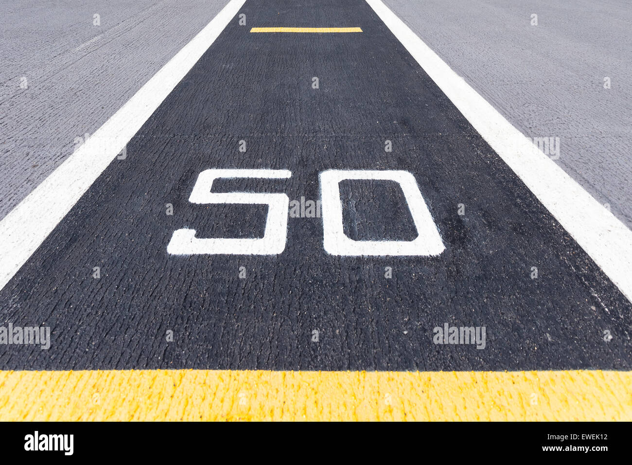 Fifty metre sign on the road. - Stock Image