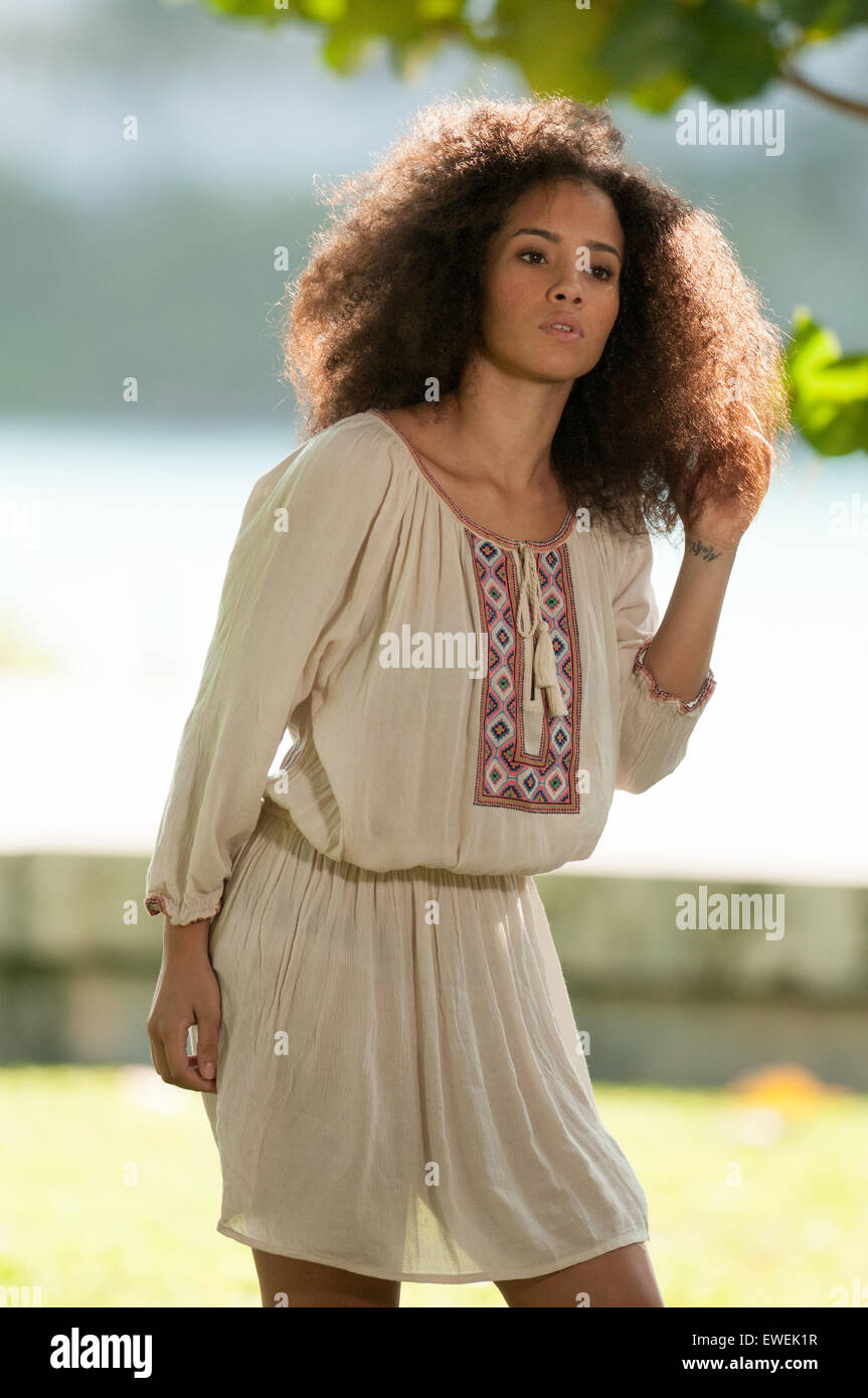 Girl With Long Curly Hair Wearing A 70 S Style Hippie Dress In The Stock Photo Alamy