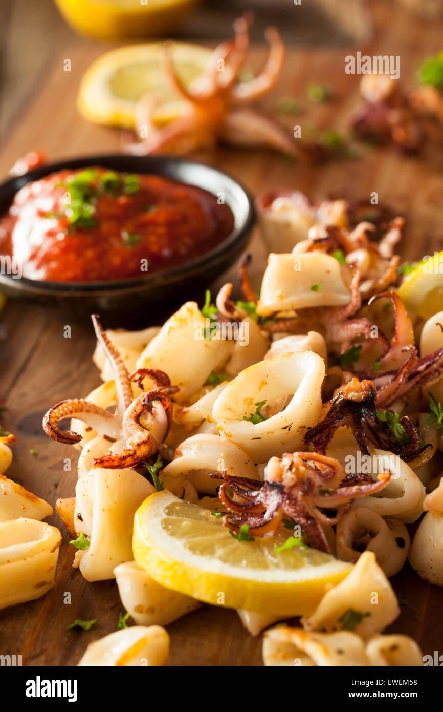 Homemade Fresh Grilled Calamari with Lemon and Sauce - Stock Image