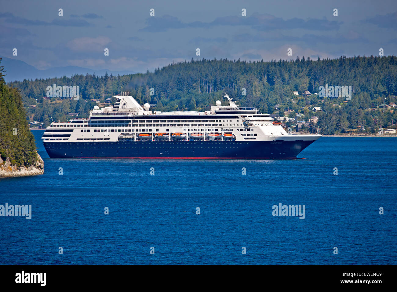 Holland America 'Statendam' cruise ship passing by Haddington Island and Sointula on Malcolm Island off - Stock Image