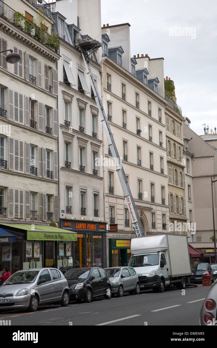 Street scene with a moving truck and elevated lift for moving personal possessions  in Paris, France - Stock Image