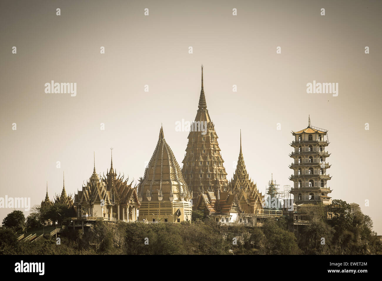 Retro stylized photo of Wat Tham Sua(Tiger Cave Temple), Tha Moung, Kanchanburi, Thailand - Stock Image