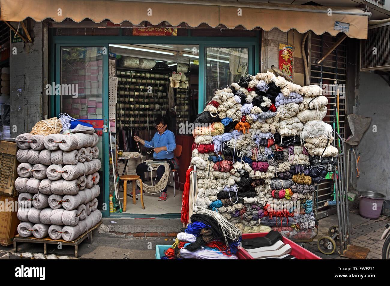 Shanghai - Huangpu  District China Chinese ( Tailor garment sew needlework  ) - Stock Image