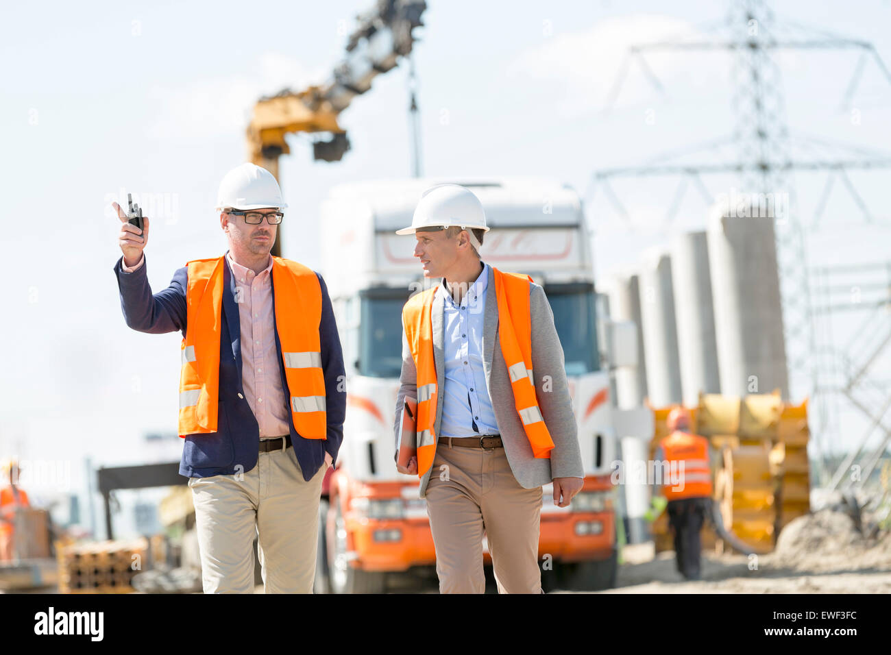 Supervisors discussing at construction site - Stock Image