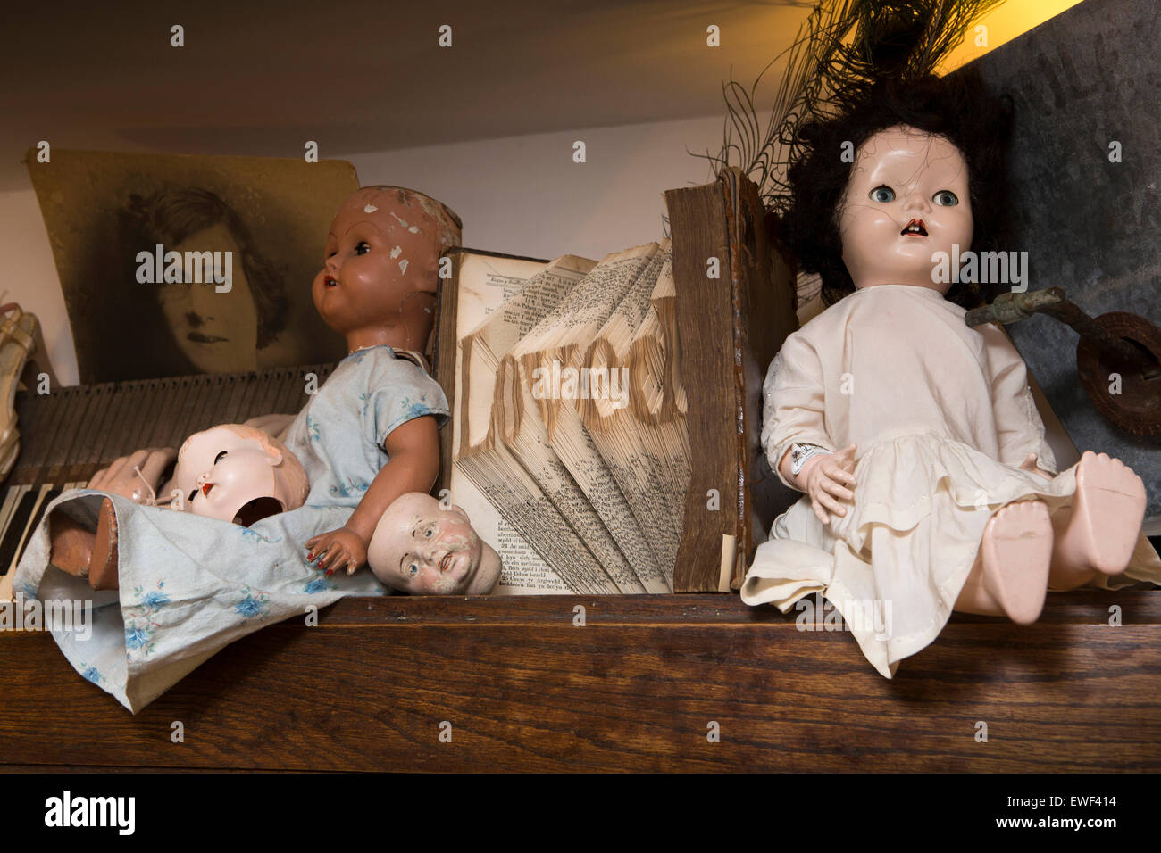 UK, England, Shropshire, Bridgnorth, Bank Street, A'tique shop, dolls and book folded into word 'loved' - Stock Image