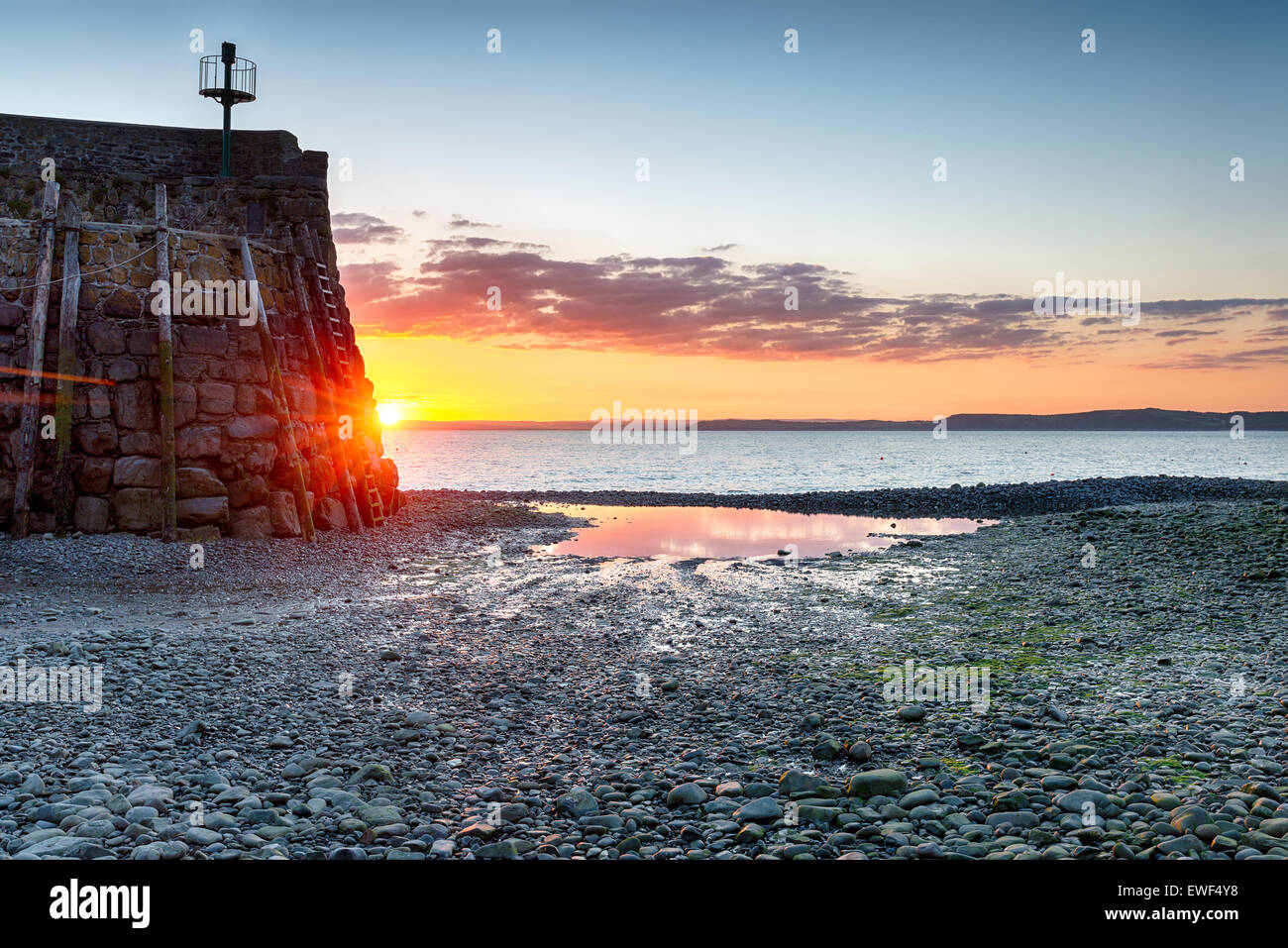 Sunrise at the harbour entrance to Clovelly on the north Devon coast - Stock Image