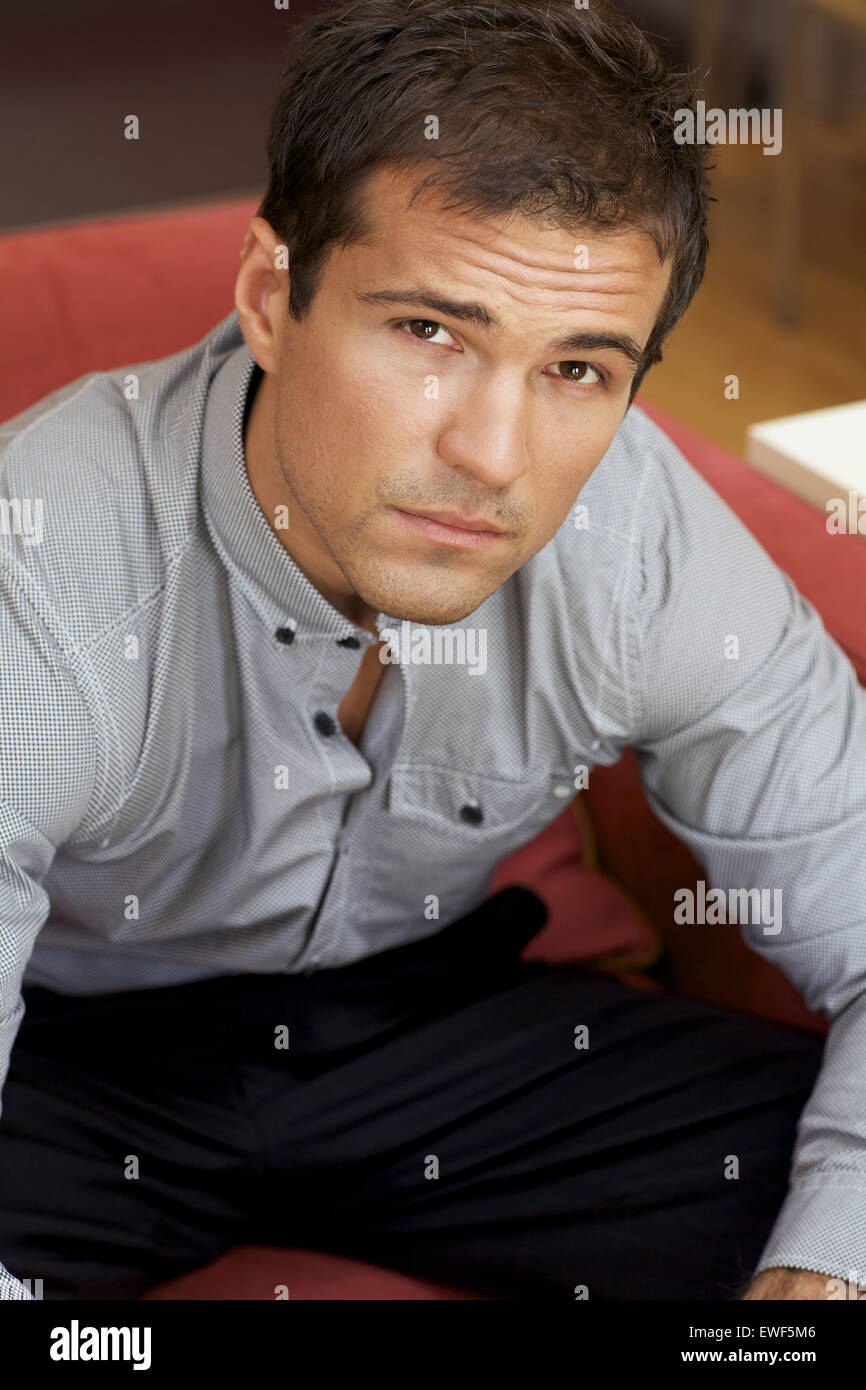 Portrait of young man contemplating - Stock Image