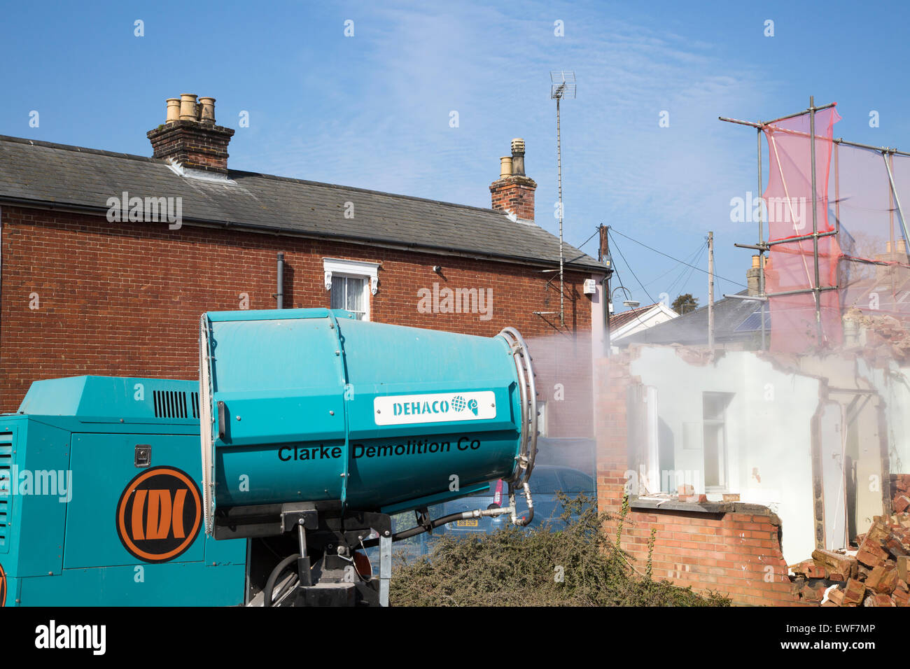Dehaco water cannon sprayer dampening dust at a demolition site, Woodbridge, Suffolk, England, UK - Stock Image