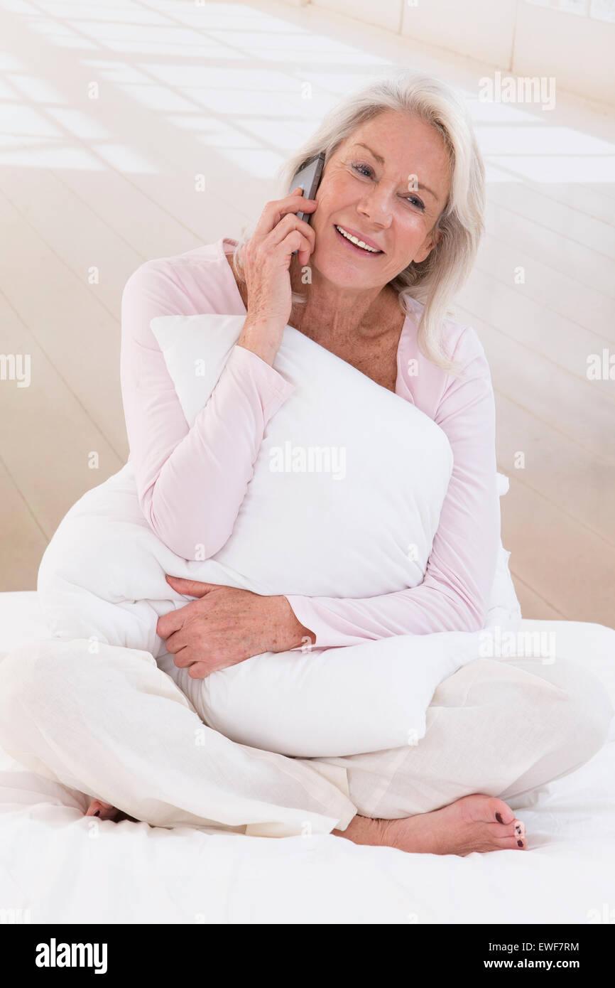 SENIOR ON THE PHONE - Stock Image