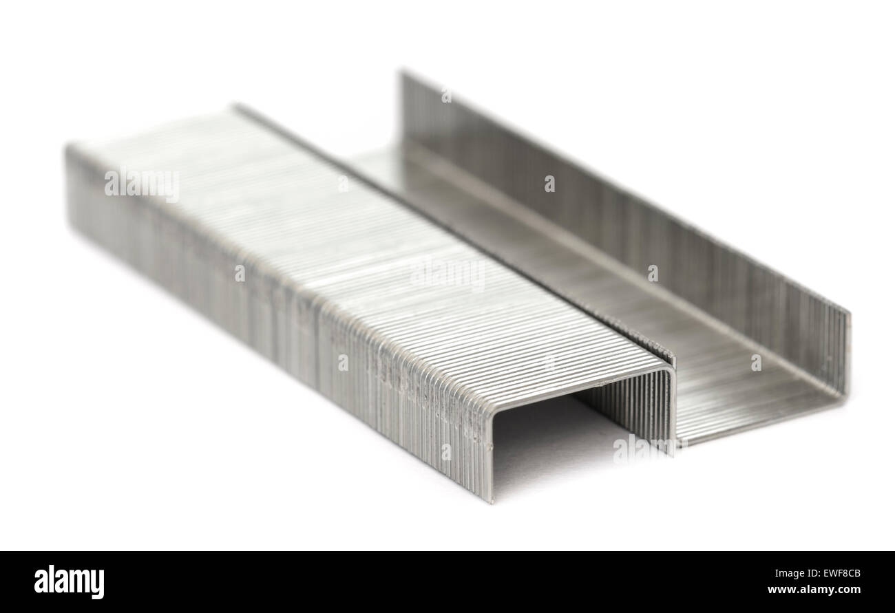 Staples. Closeup of a pair of strips of staples on a white background. - Stock Image